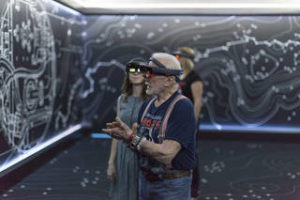 "Apollo 11 astronaut Buzz Aldrin, right, and Erisa Hines of NASA's Jet Propulsion Laboratory in Pasadena, California, try out the Microsoft Hololens mixed reality headset during a preview of ""Destination: Mars"" at Kennedy Space Center visitor complex in Florida. Based on OnSight, a tool created by JPL, ""Destination: Mars"" lets guests experience Mars with holographic versions of Aldrin and Hines as guides. Credits: NASA/Charles Babir"